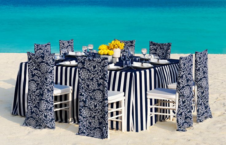 Navy Blue and white destination beach reception At Weddings Romantique, we will be glad to help you plan your Stylish All Inclusive Destination Wedding, we will take care  of your destination wedding services from sourcing the right vendors, creating a stylish event that reflect your personality and budget to all the legal requirements for getting married on away from home in addition to providing you personalized group travel arrangements for all your guests.