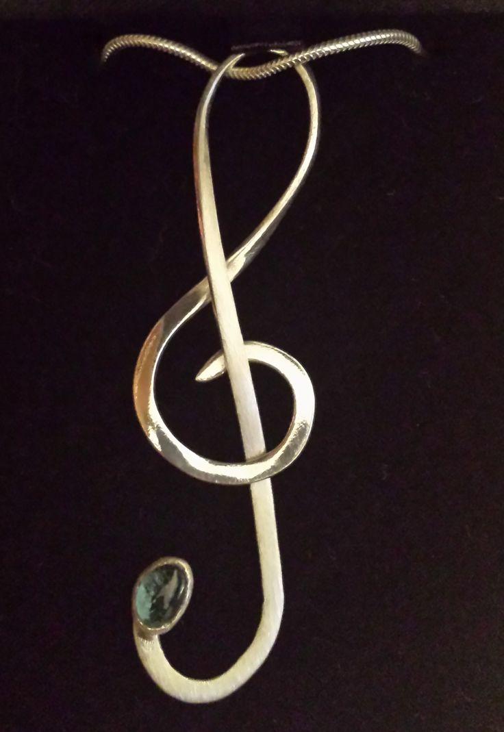 Silver and blue topaz treble clef