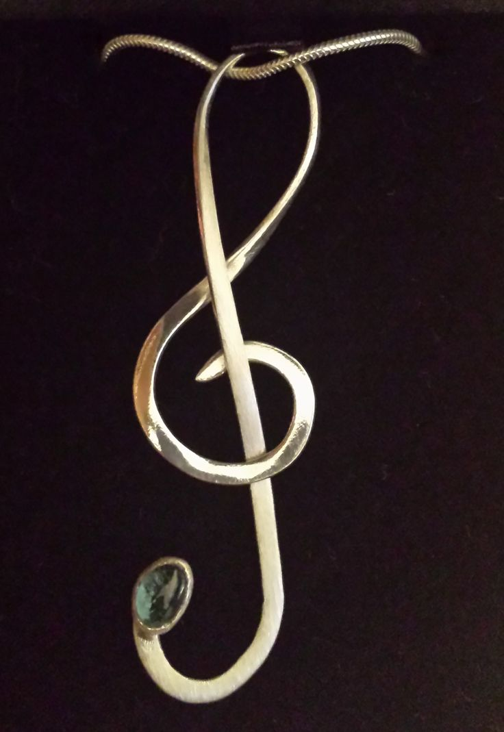 Silver and blue topaz treble clef