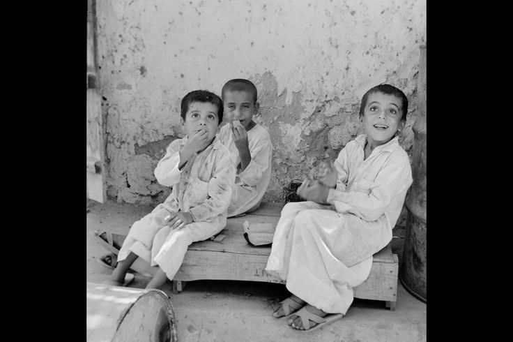 These three young men would now be in the their mid-50s. In a country that has changed so much, it is impossible but intriguing to wonder about their fortunes. What we do know is that this photo was taken in 1963 by Guy Gravett, a British photographer working for BP who visited what were then the Trucial States several times.  * James Langton - See more at: http://blogs.thenational.ae/photography/national-view/time-frame-simpler-times#1