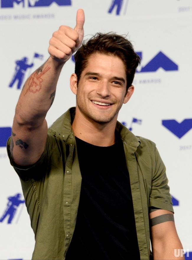 Tyler Posey arrives for the 34th annual MTV Video Music ...  Tyler Posey arr...