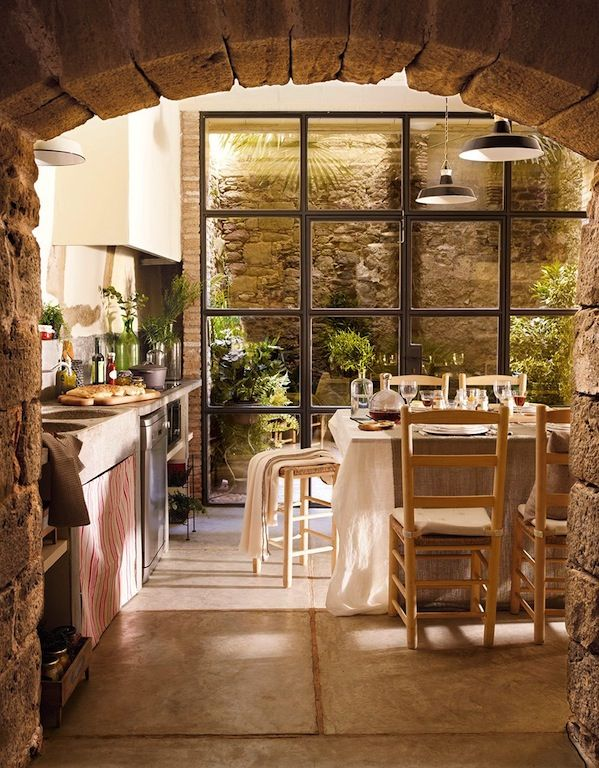 Love this kitchen...stone walls and wall of windows via Raindrops and Roses