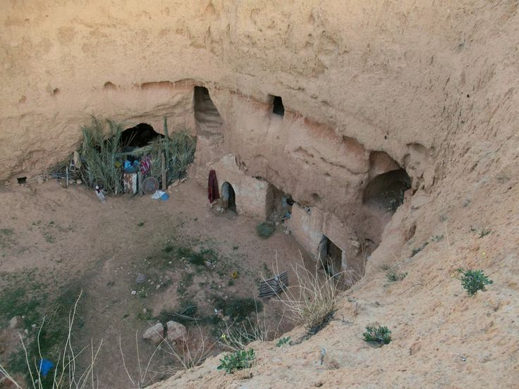 To escape the desert heat Berber troglodytes still live in pit dwellings such as this one at Matmata, Tunisia.