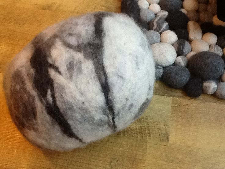Felted stone.  Inside is filling from a pillow, so its superlight.