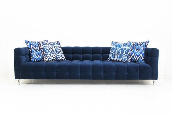 """Say hello to the brand new DeLano Sofa. Its an elegant addition to the our sofa line, featuring beautiful and luxurious biscuit tufting, 4"""" Lucite legs and finished in lush navy velvet. 8' Long / 36"""""""