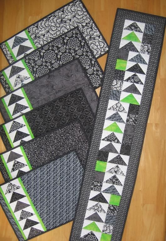 Geese Across the Table - placemats and matching runner.  Flying geese and bright accents.  Pattern @ https://payhip.com/CanuckQuilterDesigns or www.crafsty.com/canuckquilter