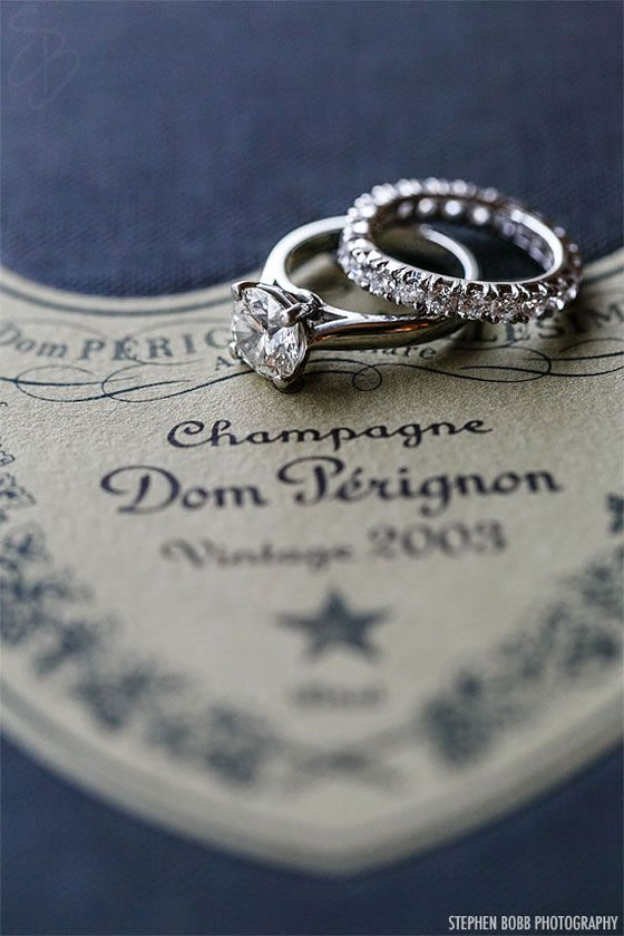 Spectacular Wedding rings on a Dom Perignon label Stephen Bobb Photography