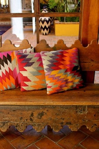 love this old bench with colorful cushions in Carole Meyer's home in San Miguel de Allende