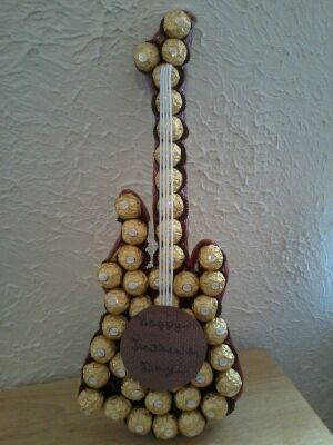 This is a guitar made of Ferrero Rocher candy and Twizzlers. The Twizzlers are all around the sides of the guitar. I made this gift for my dad for father's day.