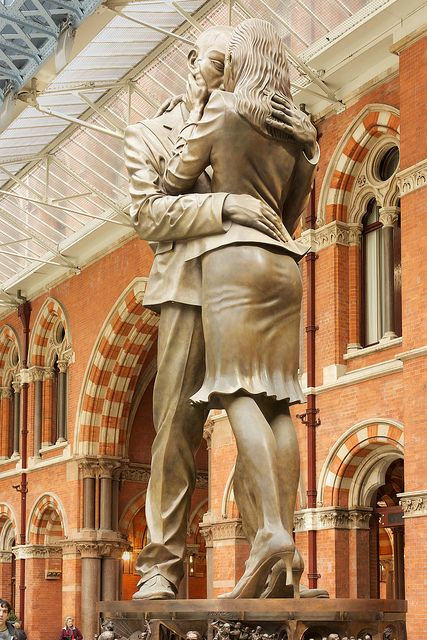 """The Meeting Place ~ is a 30 ft statue, by artist Paul Day, which stands under the railway at St. Pancras Station. The piece is intended to reflect the Romanticism of train travel and is reminiscent of a scene from the film """"Brief Encounter"""" , London."""
