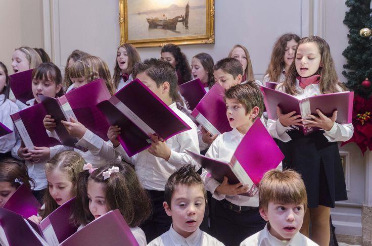 Choir of children singing Christmas carols