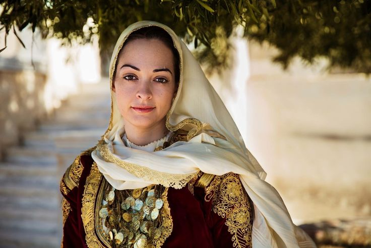 This woman from Greece wears an amazing old costume, inherited from her…