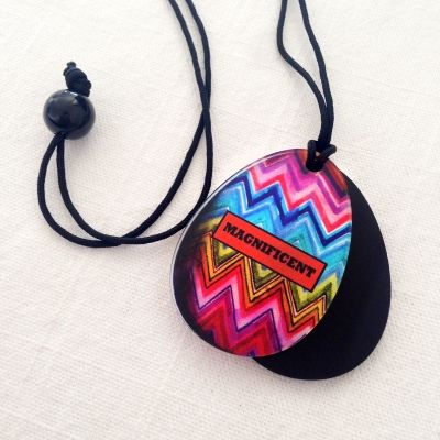 magnificent easter pendant An elegant pendant  totally handmade. The treasured stylish egg design is crafted out of plexiglass and comes in a black velvet gift purse. dimensions: Each egg measures approximately 5 cm long. It hangs on a long red cotton cord with a black beed finishing.  #storymood #pendants #easter #giftsforher