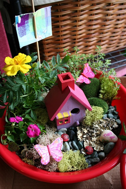 My daughter would love a fairy house like this in her little flower garden next summer