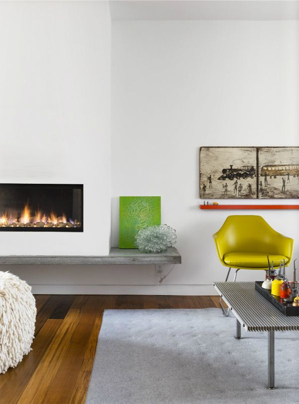 My dream of a fireplace continues. Love the concrete surround. A FOOD STYLIST'S HOME IN TORONTO, CANADA | THE STYLE FILES