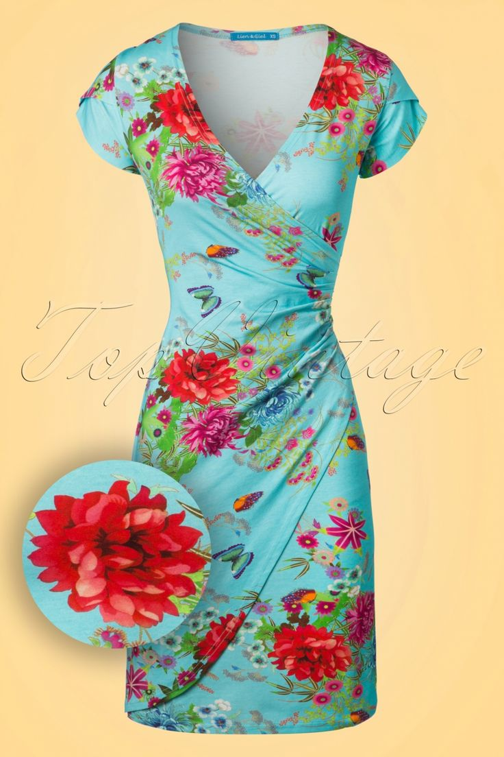 Get into the summer mood with this 60s Buenos Aires Butterfly Dress! The colourful floral and butterfly print makes the sun come out! Eyecatching wrap over dress featuring a deep V-neckline creating a sexy cleavage and super flattering for your figure due to the smart pleats at the side ;-) She