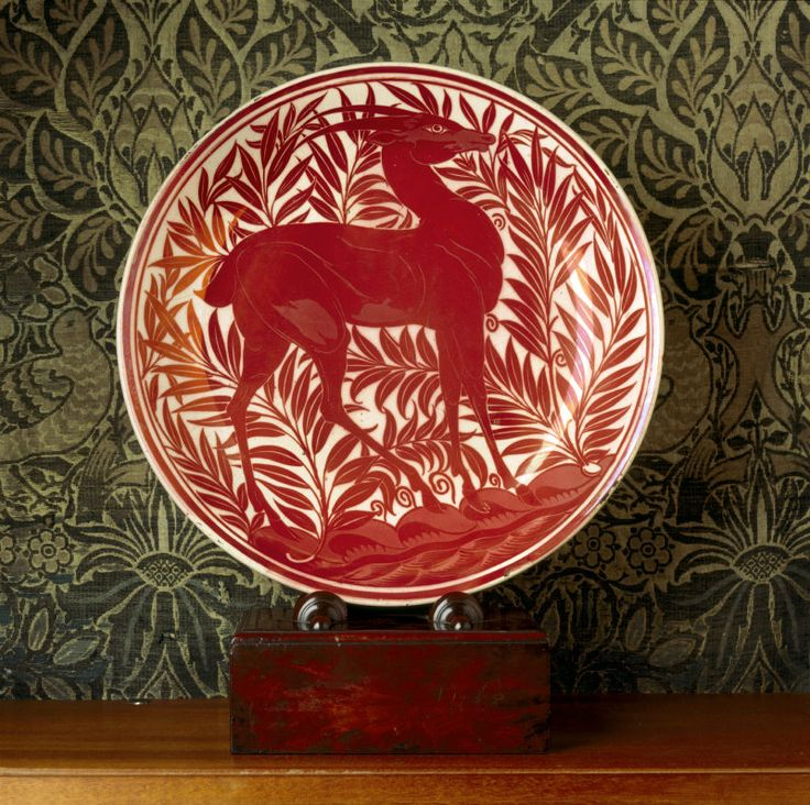 Red and white Arts & Crafts era lustreware plate with gazelle(?) and foliage by William De Morgan, at Wightwick Manor. ©NTPL/Andreas von Einsiedel