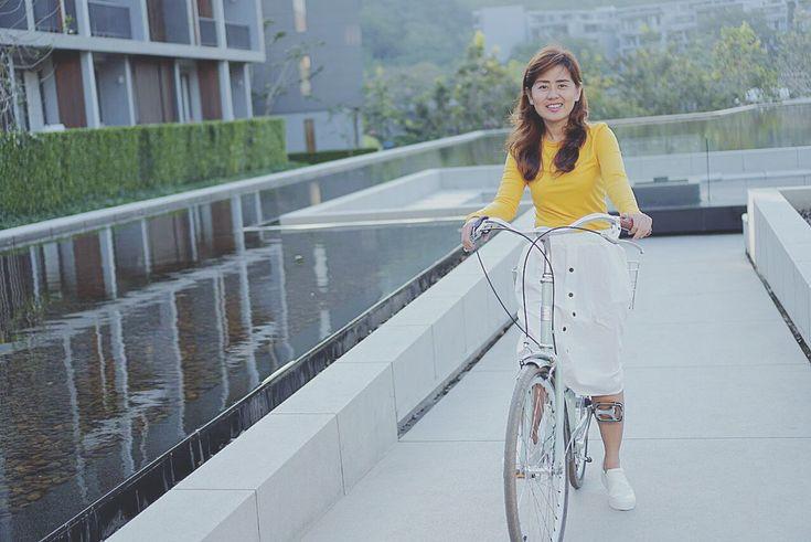 Yellow shirt white skirt & bike