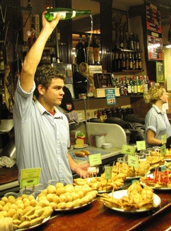 Places to go at #Easter? Check this out!! Waiter serving Txakoli and tapas in #Bilbao-North Spain