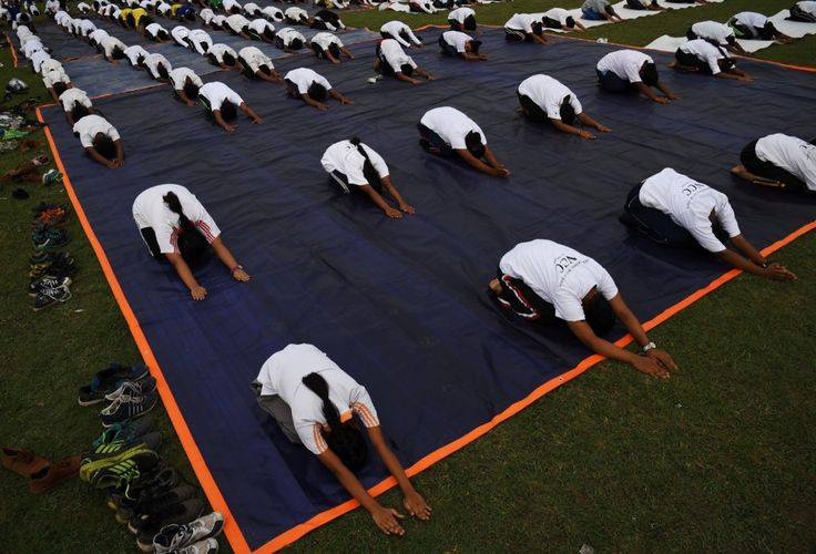 Members of India's National Cadet Corps take part in a mass yoga session in Kolkata. DIBYANGSHU SARKAR/AFP/Getty Images