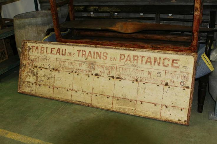 Vintage French train station schedule sign