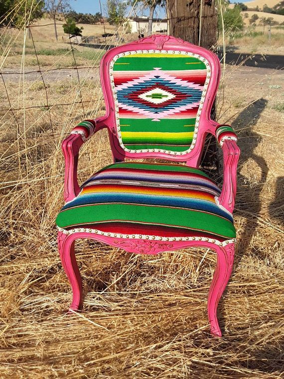 This antique victorian chair has been refinished in a distressed hot pink and adorned with a vibrant 1930s serape blanket from Mexico. The chair is finished off with shiney brass nailhead. Perfect seating for a living space, entryway or at a desk these cheery colors are sure to lighten