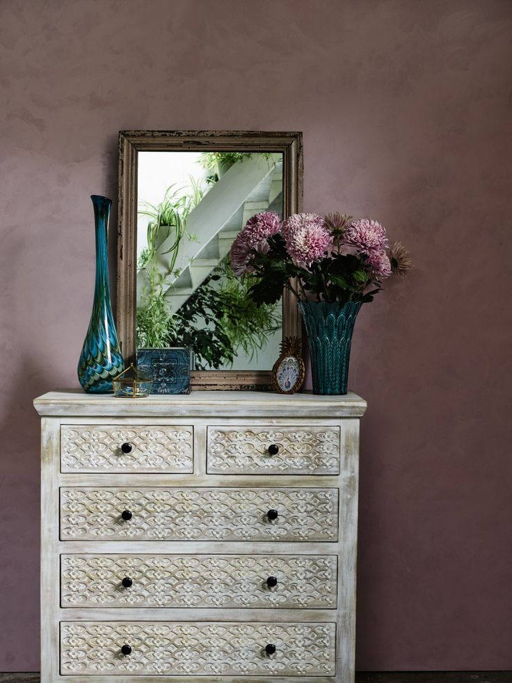 This beautiful narrow bedside cabinet is made from solid mango wood with a distressed effect, detailed with floral carvings.
