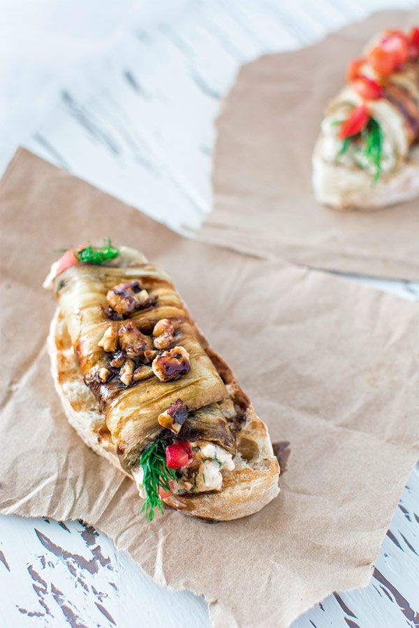 Eggplant roulades stuffed with creamy feta cheese, fresh tomatoes and toasted walnuts.