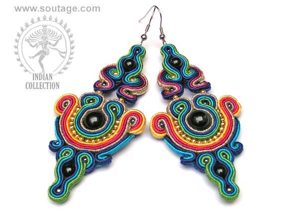 Raksha earrings are the breath of ancient India. There are the colors of temples and floral wreaths. Using materials: onyx stones, Hematite stones, glass beads, soutache, viscose, Length of earring: 9 cm Width of earring: 4 cm Handmade by soutache technique. Its possible to order in