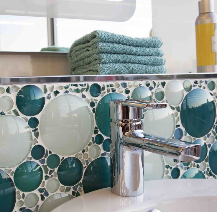 A bubble #mosaic makes for a pretty and playful feature wall behind a basin