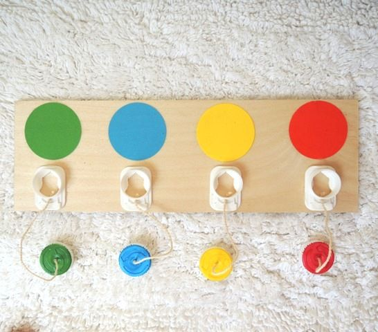Milk caps to make a Color matching screw game~good for fine motor skills
