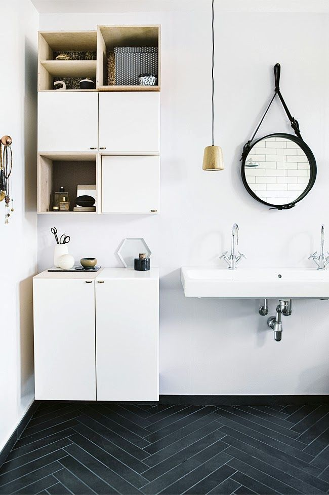 functional bathroom in black and white with copper accents
