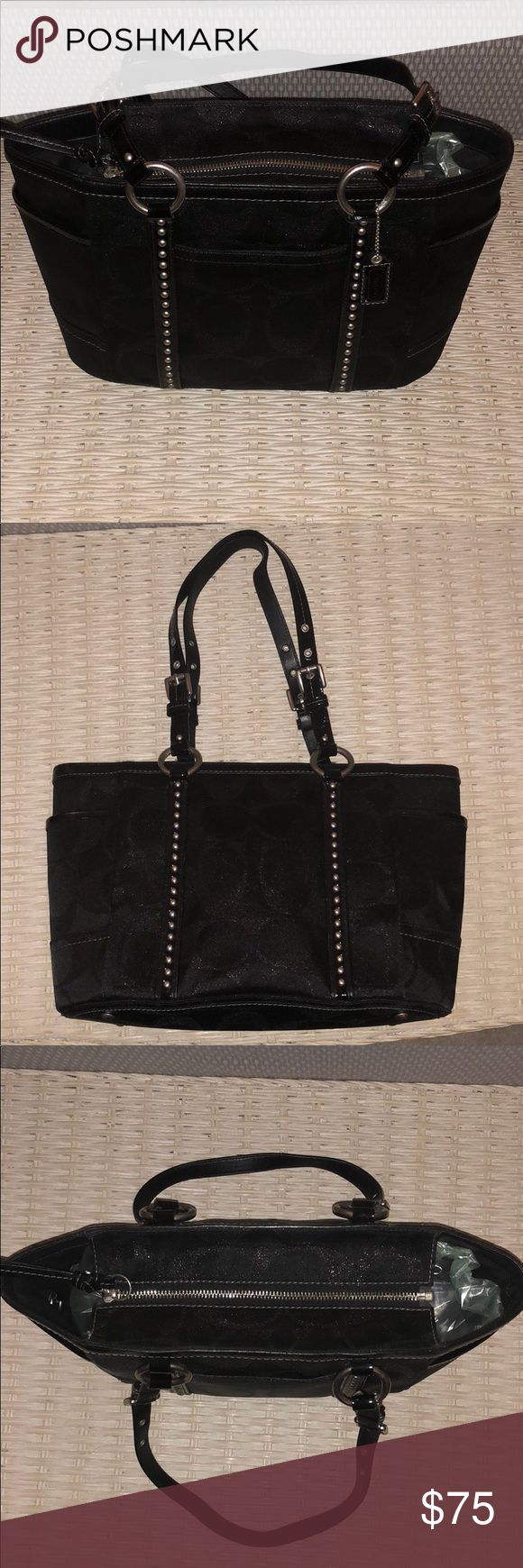 """Gently used Coach Tote Bag Coach F12853 Black Studded Lurex Sig Gallery Tote shoulder bag. Excellent condition COACH BLACK CANVAS SILVER STUDDED PURSE The canvas is a black metallic with C logo, and patent leather accents.  Silver tone hardware.  Two side pockets and an extra back pocket 5""""  Inside is semi-gloss Black  lining with zippered pocket and two slide pockets Coach Bags Shoulder Bags"""