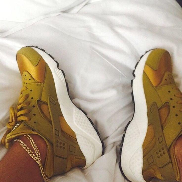 Gold Nike Huaraches.