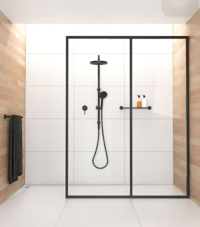 Bathrooms & minimal design don't often go together, but this sleek shower fits the bill. Combine black fixtures, white tile, & wood walls & you've got chic minimalism.
