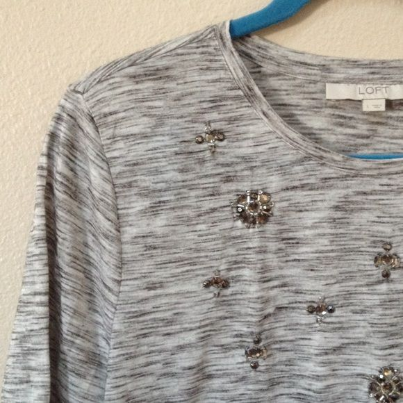 Ann Taylor Loft too This is a nice Ann Taylor loft top in excellent condition. No holes or stains. Size large. Materials include 90% polyester and 10% rayon. Ann Taylor Tops
