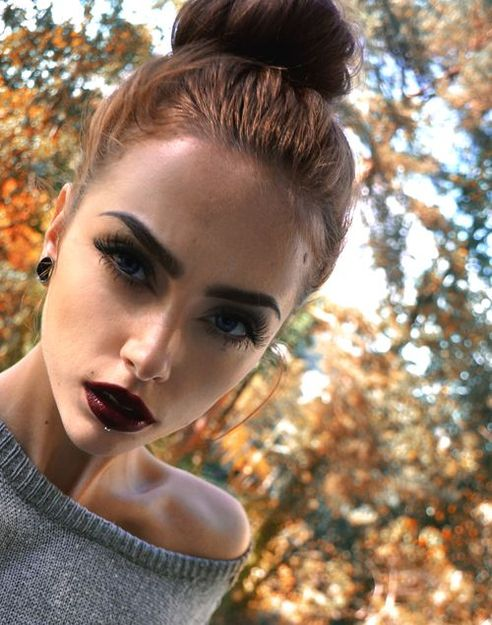 Top knot? Check! Bold brows? Dark lips? Check and check!