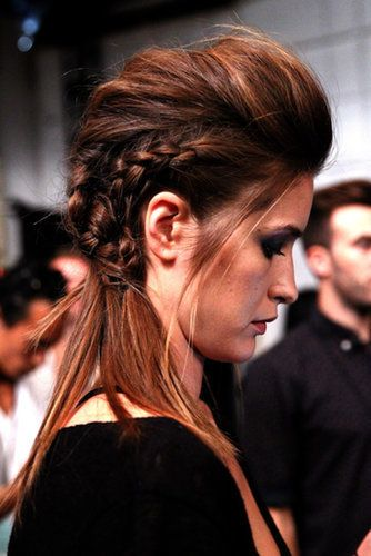 The second style at the Marissa Webb show was part braided undercut, part pompadour. Jeanie Syfu started with two cornrows along the sides and finished with a looser french braid down the center. This look is not for beginner braiders!  Source: Getty / Astrid Stawiarz