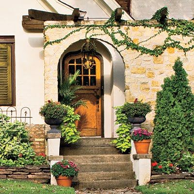 Good balance with arched entry and curved door. Nothing like plants on the steps. LJH: Feng Shui, Home Entrance, Salvaged Doors, House Exterior Design, Front Doors, House Entrance, Curb Appeal, Front Entry, Vintage Antiques