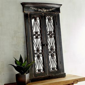 """Named after the French word meaning """"sea village,"""" our handcrafted Merville mirror delivers coastal style to any wall in your chateau. Its rustic fir frame is carved in the style of European casement windows, with cast iron scrolls for added intrigue. A one-of-a-kind focal point for any wall."""