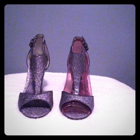 New Glittery Nina shoes New Glittery Nina shoes Silver with a hint of purple with box and dust bag. Nina Ricci Shoes Heels