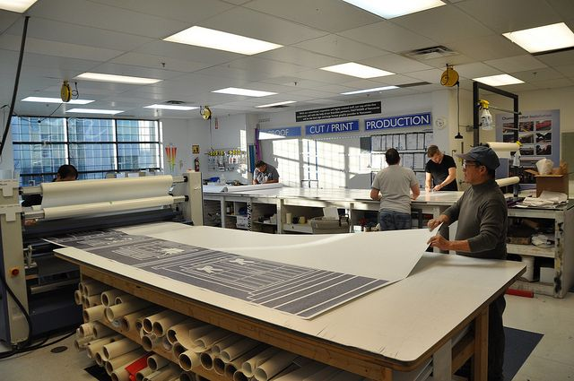 The production team printing vinyl adhesive in the Fastsigns Vancouver shop #fastsigns