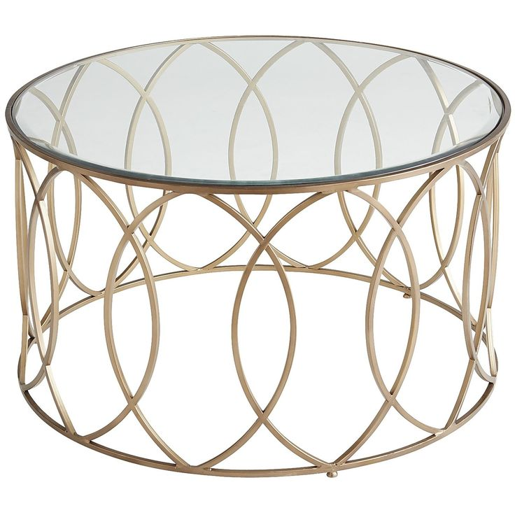 """The newest starlet to feature in your living room? Our Elana Coffee Table. Graceful and topped by beveled glass, her hand-forged geometric design works well with any supporting cast of furniture. Also known as the """"it goes with anything"""" factor."""