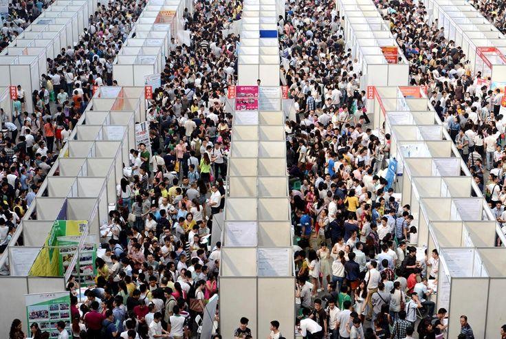 Thousands of job seekers visit booths inside a job fair in Chongqing.