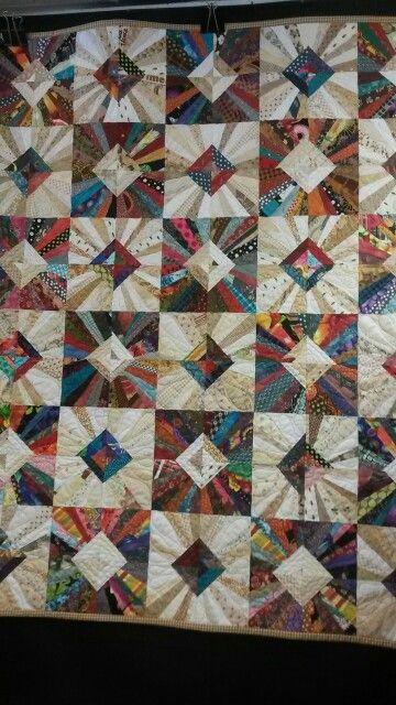 Great scrap quilt. This would be great in men's neck tie silks.