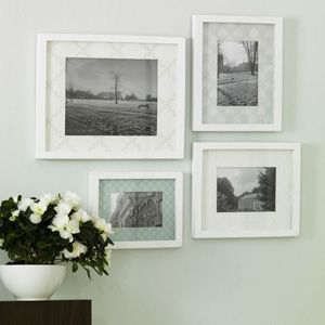 decorate picture frames w/ wallpaper