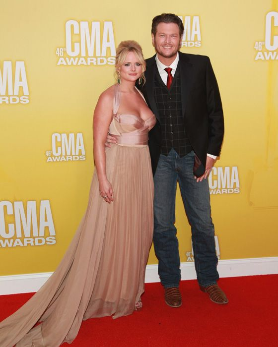 Miranda Lambert, pictured with her husband Blake Shelton, wore a Maria Lucia Hohan blush gown at the Country Music Association Awards