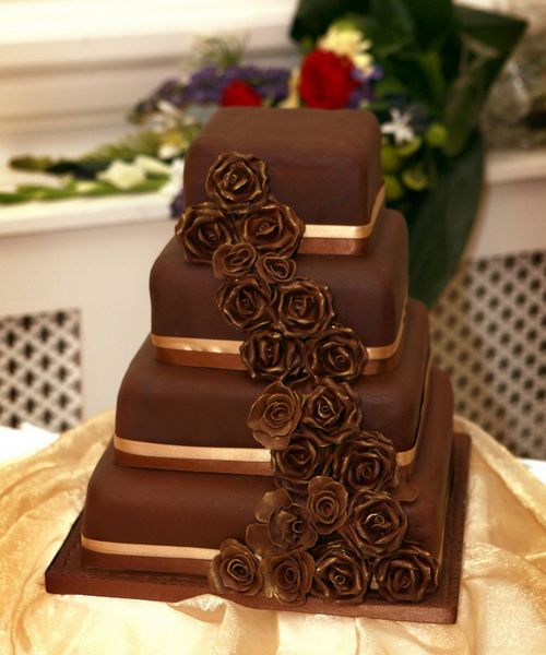 brown wedding cake chocolate wedding cake with gold ribbon and cascading 12195