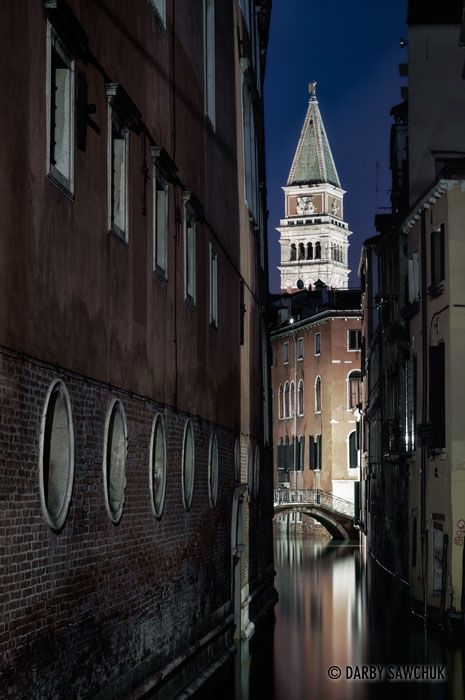 St. Mark's Campanile rises over one of the small canals, Venice