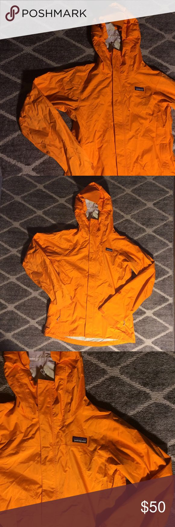 Orange Patagonia Rain Jacket Bright orange Patagonia rain jacket. Great rain jacket to brighten up a rainy day! Get this bold closet essential from me for cheap! :) Patagonia Jackets & Coats